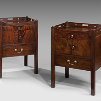 A closely matched pair of Chippendale period mahogany tray top commodes. Thumbnail 1