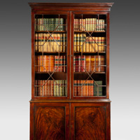 A Chippendale period mahogany cupboard base bookcase. Thumbnail 1