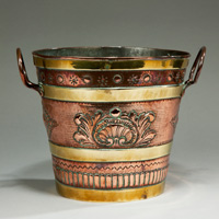 An antique 19th Century copper and brass jardiniere.