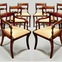 A set of 12 Regency style dining chairs