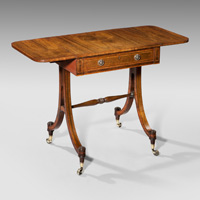 A Regency period rosewood sofa table of small proportions. Thumbnail 1