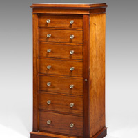 A good Regency period mahogany wellington chest. Thumbnail 1