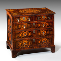 Antique William and Mary oyster veneered chest.