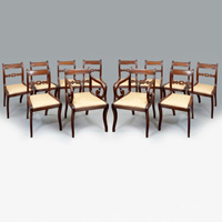 A set of 12 antique Regency mahogany dining chairs