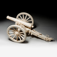 A 19th Century bone model cannon.