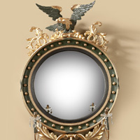 A good Regency period carved giltwood and bronzed convex mirror. Thumbnail 1