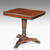 A fine Regency period rosewood veneered and brass inlaid centre table. Thumbnail 1