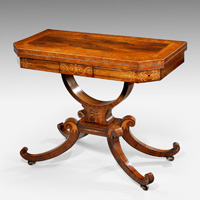 An elegant Regency period rosewood veneered card table. Thumbnail 1
