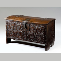 A beautifully carved 17th Century oak coffer. Thumbnail 1