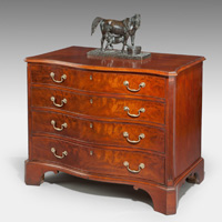 A handsome Chippendale period mahogany serpentine fronted commode. Thumbnail 1