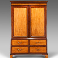 An antique Hepplewhite period linen press.