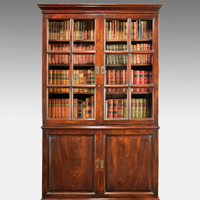 A beautifully patinated George II period mahogany cupboard base bookcase. Thumbnail 1
