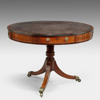 An antique Georgian drum table.
