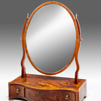 An elegant Sheraton period mahogany veneered serpentine fronted dressing mirror. Thumbnail 1