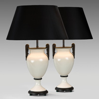 A pair of table lamps in white glass and bronze.