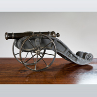 An antique model of a cannon.