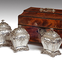 A fine Chippendale period mahogany caddy retaining its original silver canisters. Thumbnail 2