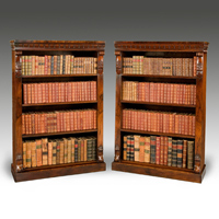 A fine pair of William IV period carved rosewood open bookcases. Thumbnail 2