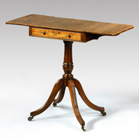 An elegant Regency period rosewood veneered sofa table of small proportions.  Thumbnail 2