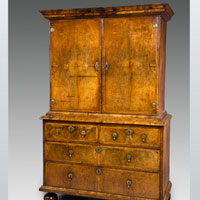 A well patinated Queen Anne period walnut veneered cabinet on chest. Thumbnail 2