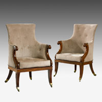 A fine pair of Regency period carved mahogany bergere armchairs. Thumbnail 2