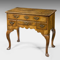 A beautifully patinated Queen Anne period walnut veneered lowboy. Thumbnail 2