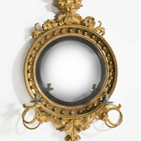 A fine Regency period carved giltwood convex mirror. Thumbnail 2