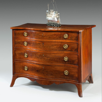 An elegant Sheraton period mahogany veneered serpentine chest. Thumbnail 2