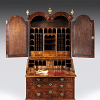A William and Mary period walnut veneered double domed bureau bookcase. Thumbnail 2