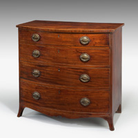 A Sheraton period faded mahogany bowfronted chest of drawers. Thumbnail 2