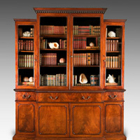 A handsome Chippendale period mahogany breakfront bookcase. Thumbnail 2