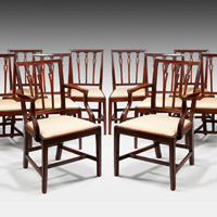A well patinated set of twelve (10+2) Sheraton period mahogany dining chairs. Thumbnail 2