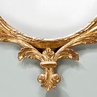 An antique Georgian Chippendale giltwood mirror.