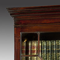 A Chippendale period mahogany cupboard base bookcase. Thumbnail 2