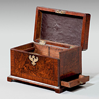 An antique George II walnut tea caddy.