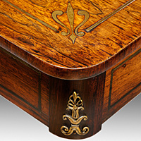 A Regency writing table veneered in rosewood.