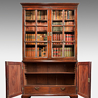 A beautifully patinated George II period mahogany cupboard base bookcase. Thumbnail 2