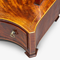 An elegant Sheraton period mahogany veneered serpentine fronted dressing mirror. Thumbnail 2