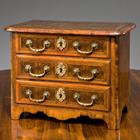 Antique miniature commode in kingwood