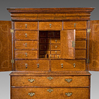A rare Queen Anne period burr yew veneered cabinet on chest. Thumbnail 3