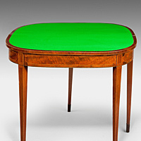An antique Sheraton mahogany card table.