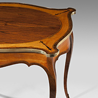 An antique Hepplewhite satinwood centre table.